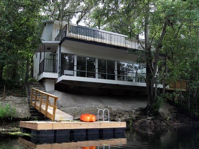 View of the house and floating dock from the river