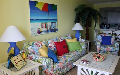 Spacious living area beautifully decorated in bright, cheerful colors.