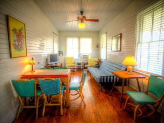 Tybee Island cottage photo - Sunny, Upstairs livingroom with futon. Huge cast iron Hunter ceiling fan.