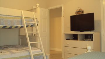 3rd bedroom with bunkbed and additional twin bed plus flatscreen TV