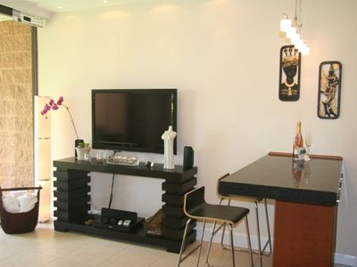 "New: designer furniture, 42"" HDTV, entertainment system, fan, lights...."