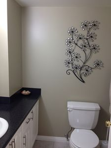 Ensuite bathroom is very bright and cheery. Walk in shower has new fresh tiles.