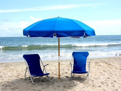 BEACH CHAIRS, BEACH TOWELS, AND UMBRELLA PROVIDED