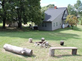 Harpers Ferry house photo - campfire ring and wooded back yard