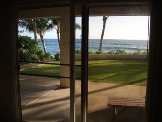 Makaha studio photo - Looking out sliding glass door to oceanfront and lawn. Total privacy here.