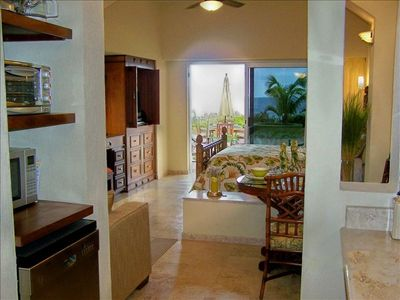 The pool deck and beach are just outside the door.