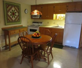 Comfortable seating for four in kitchen/dining area.