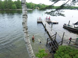 Sebago Lake Basin cottage photo - Sandy bottom swimming area and canoe launch