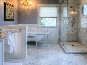 Heated marble floors, two person starglass shower and a chandelier...