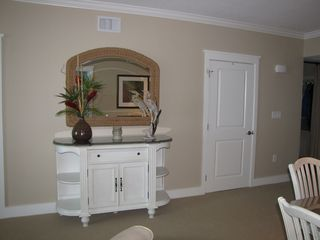 Fort Walton Beach condo photo - Buffet cabinet and door to half bath.