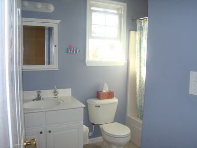 Nicely painted and super clean full bathroom with tub/linen closet/window.