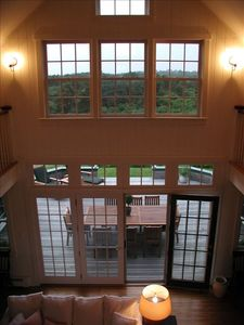 Main house, view from balcony to back deck & conservation land