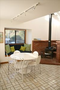 dining area and wood stove in larger unit