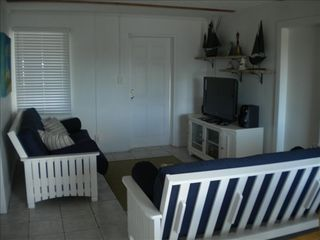 Cherokee Sound property rental photo - Living Room ,TV-DVD ,Stereo-CD stand ,front door with large window A/C