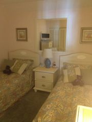 Tropical Theme Twin Bedroom. TV and Dresser reflected in mirror! - Myrtle Beach Resort condo vacation rental photo