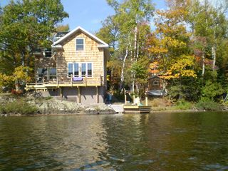Lake Medora cottage photo - Cottage, dock and sauna - fish off the deck or dock, swim off the dock, soak up