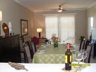Naples condo photo - View from Kitchen - Dining w/ Lanai at background