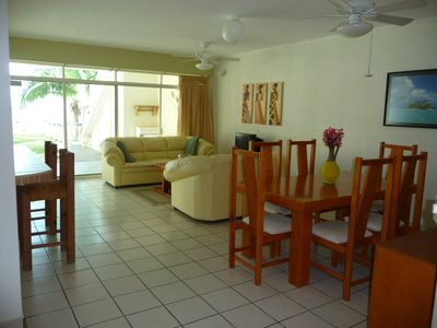 Comfortable Living & Dining Room open onto the poolside terrace. Main House