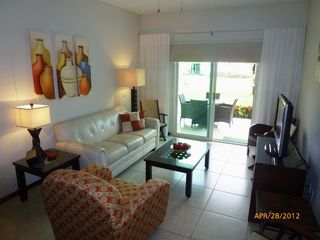 Nuevo Vallarta condo photo - Living room walks out to sun screened,tiled patio with view of fountain.