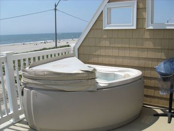 Two person hot tub on ocean front deck