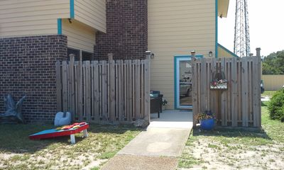 Entrance to rental through fenced patio area