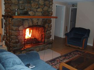North Conway house photo - Lovely field stone fireplace for apres ski!