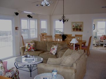 Great room and dining room- table seats 10, sunroom in background