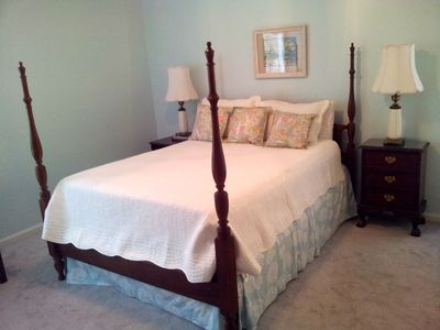 Large master bedroom with queen bed, TV, private bathroom, and spacious closet.