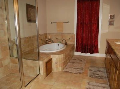 Luxurious Master Bath with , double vanity,garden tub, walk in shower and closet