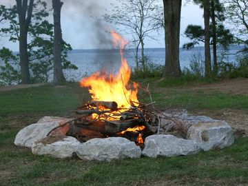 Enjoy evenings sitting around your private stone camp fire.