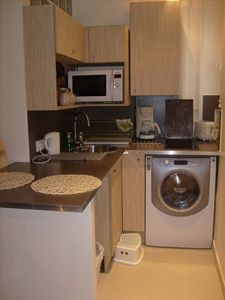 - Kitchen (window), open to living room, fully equipped (washing machine-dryer)