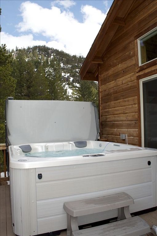 Enjoy views of echo summit and Cowboy mountain as you relax in the hot tub