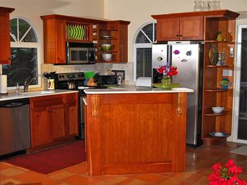 The kitchen has up-to-date amenities (and beautiful cabinets) for group cooking
