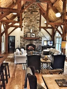 Light filled great room, soaring fireplace, post and beam architecture....