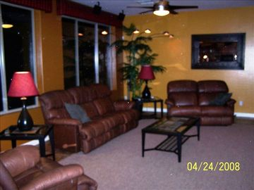 Downstairs living room. All couches are recliners and 65 inch big screen t.v.