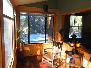Idyllwild cabin rental - The enclosed sun porch on a winter day. The new heating system keeps the sun porch warm even when there is snow outside, as there was the day this was taken.