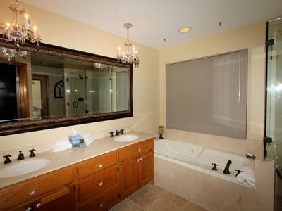 Updated Master Bathroom has double sinks, with extra long jetted tub and shower