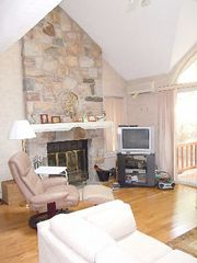 Poconos Pines - Pinecrest Lake townhome photo - fireplace and entrance to the deck