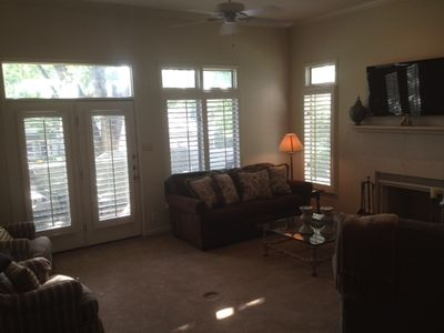 Relax in comfortable living area; french doors open to small patio; sofa-bed
