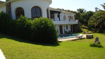 Luxury villa with garden, private pool, terrace, bbq, and sea