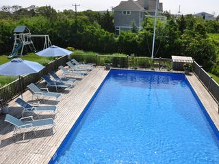 Montauk house photo - Upper deck view of the pool and playground