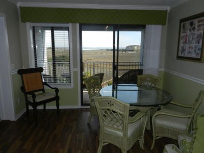 Dining area looking out to balcony