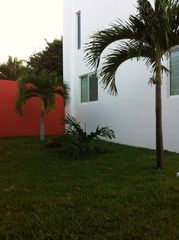 Isla Mujeres house photo - Side yard of grass