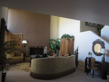 high vaulted ceiling living room ( now has flat screen t.v. over fireplace )