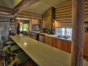 .KItchen in main cabin, open to the living room.