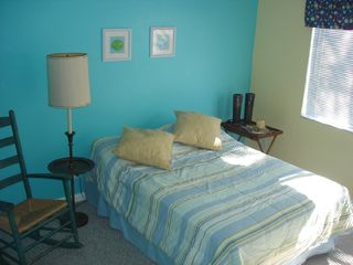 Naples condo photo - Bright guest bedroom with rocking chair