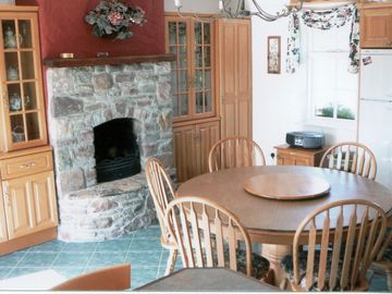 Hearth warmed kitchen dining