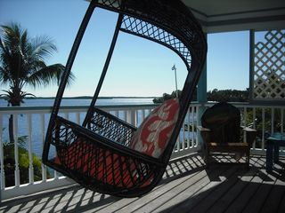 Key Largo house photo - Unwind in one of the three patio swing chairs