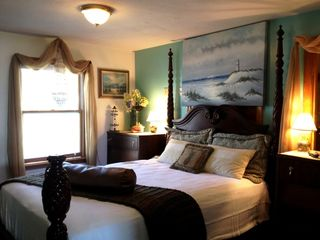 Rye condo photo - 4post Queen Mahogany bed. Sea glass lamps, flat screen TV - Bahama blue colour.