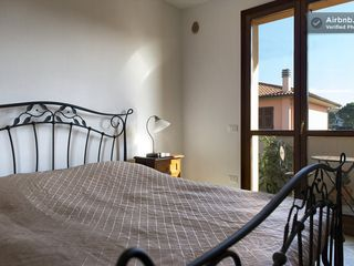 Montopoli Val d'Arno house photo - Queen bed and traditional decor make it cozy, balcony makes it romantic.
